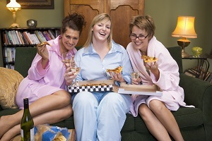 Three young women eating