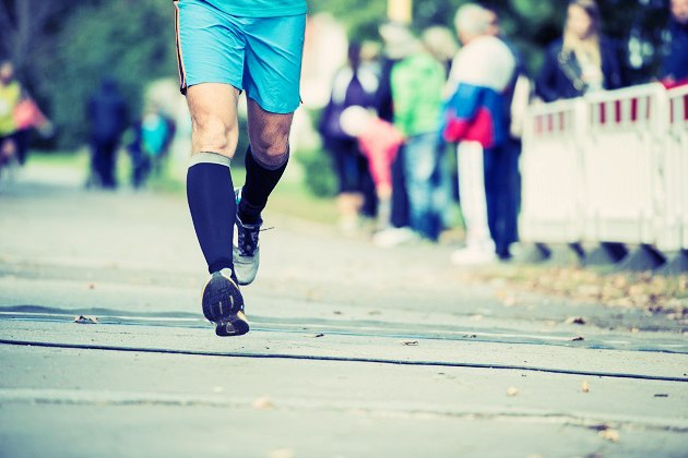male runner in compression socks