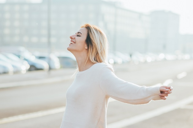 woman feeling free with arms wide open