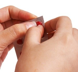 Removing A Pill From Its Packet