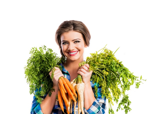 woman with carrots and parsley